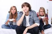 Three teenagers playing computer game — Stock Photo