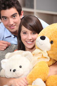 Couple and plush — Stock Photo