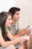 Young couple playing computer games — Stock Photo