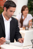 Man with laptop in a restaurant — Stock Photo