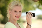 Woman with binoculars — Stock Photo