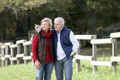 Couple spotting an animal in the countryside — Stock Photo