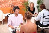 Couples eating in a restaurant — Foto de Stock