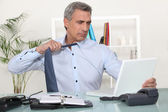 Man undoing his tie at the end of the day — Stock Photo
