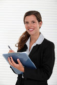 Office worker with a clipboard — Stock Photo