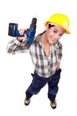 Tradeswoman holding a power tool — Stock Photo