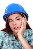 A tired-looking tradeswoman — Stock Photo