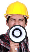 A construction worker calling a strike. — Stock Photo