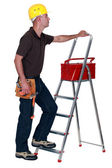 Man with a toolbox and stepladder — Stock Photo