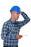 A dubious handyman with a screwdriver. — Stock Photo