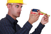 A construction worker impressed by his meter. — Stock Photo