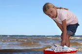 Girl playing with boat — Stock Photo