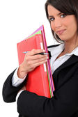 Young businesswoman holding folders — Stock Photo