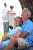Mature couple dozing in the sunshine — Stock Photo