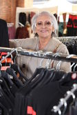 Elderly woman shopping — Stock Photo