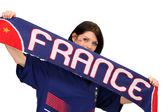 Female football fan holding a France scarf — Stock Photo