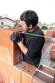 Housebuilder at work — Stock Photo