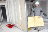 Builder carrying wall insulation — Stock Photo
