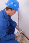 Plumber working indoors — Zdjęcie stockowe