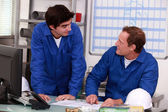 Plumbers in an office — Stock Photo