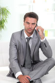Businessman in waiting area — Stock Photo