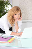 Pretty young woman with a laptop — Stock Photo