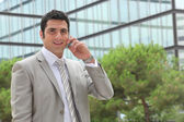 Banker having phone call outdoors — Stock Photo