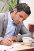 Businessman home working — Stock Photo