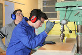 Laborers in workshop — Stock Photo
