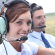 Stock Photo: Female pilot of light aircraft