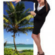 Female travel agent showing poster of tropical beach — Stock Photo