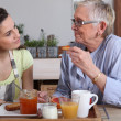 Two women talking over breakfast — Stock Photo #8330881