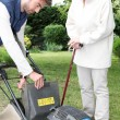 Young man gardening with older woman — Stockfoto #8330997