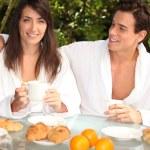 Couple having breakfast outside — Stock Photo