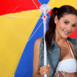 Stock Photo: Brunette holding parasol