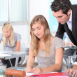 Teacher helping students in the classroom — Stock Photo #8332980