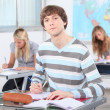 Three pupils in classroom — Stock Photo #8333055