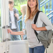 Attractive female student at entrance — Stock Photo #8333189