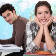 Stock Photo: Two students in geography classroom
