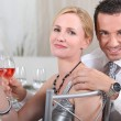 Couple with rose wine at a dinner party - Stock Photo