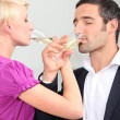 Man and woman drinking champagne with love — Stock Photo