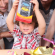 Stockfoto: Little boy opening birthday present