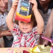 Foto Stock: Little boy opening birthday present