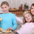 Children eating a French &#039;galette de rois&#039; - Stock Photo