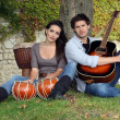 Musical couple in filed — Stock Photo