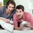 Young couple playing video games — Stock Photo