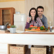 Stock Photo: Couple preparing vegetables