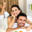 Couple laying in bed together — Stock Photo