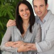 Happy couple at home — Stockfoto #8335397