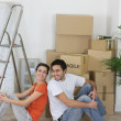 Couple sat next to packed boxes — Stock Photo